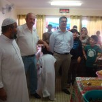 L'imam, le président de l'AMNC et le représentant du Haussaire
